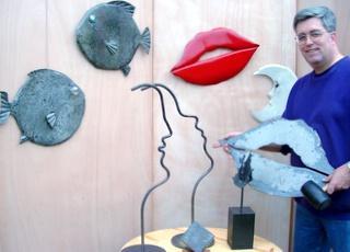 Artist Jonathan Steele With Steel Sculptures